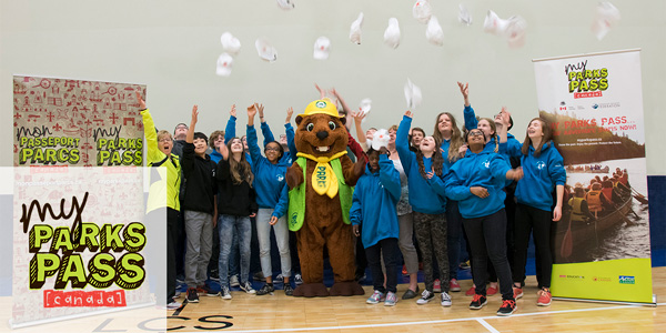 The grand prize winners of the 2017 Canada's Coolest School Trip celebrate with Parka and throw their hats in the air.